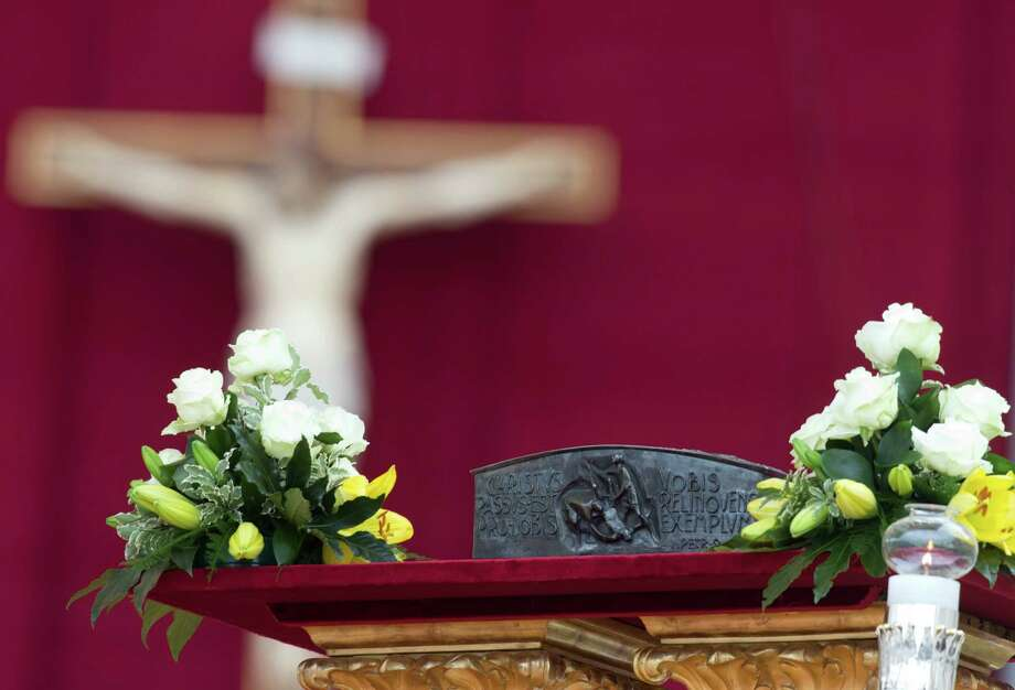 The relics of St. Peter are placed next to the altar prior to the start of a mass celebrated by Pope Francis for the end of the Year of Faith, in St. Peter's Square at the Vatican, Sunday, Nov. 24, 2013. (AP Photo/Andrew Medichini) ORG XMIT: AJM109 Photo: Andrew Medichini / AP