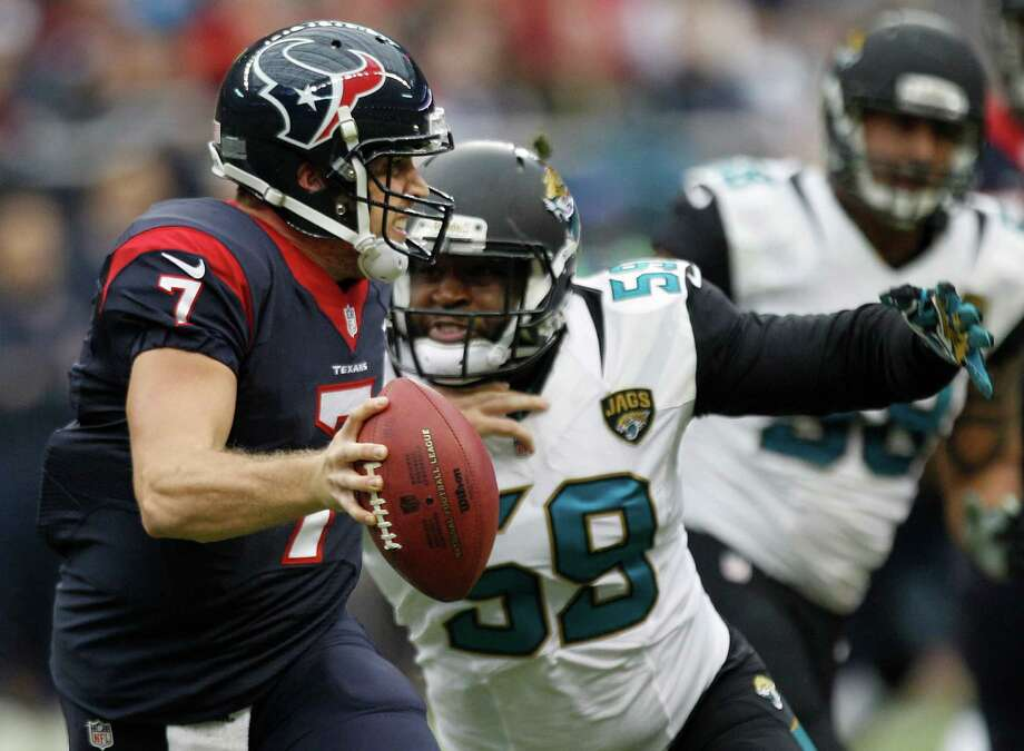 Texans QB Case Keenum is pressured by Jaguars defensive end Ryan Davis. Keenum was 18-for-34 for 169 yards and an interception. Photo: Brett Coomer, Staff / © 2013  Houston Chronicle