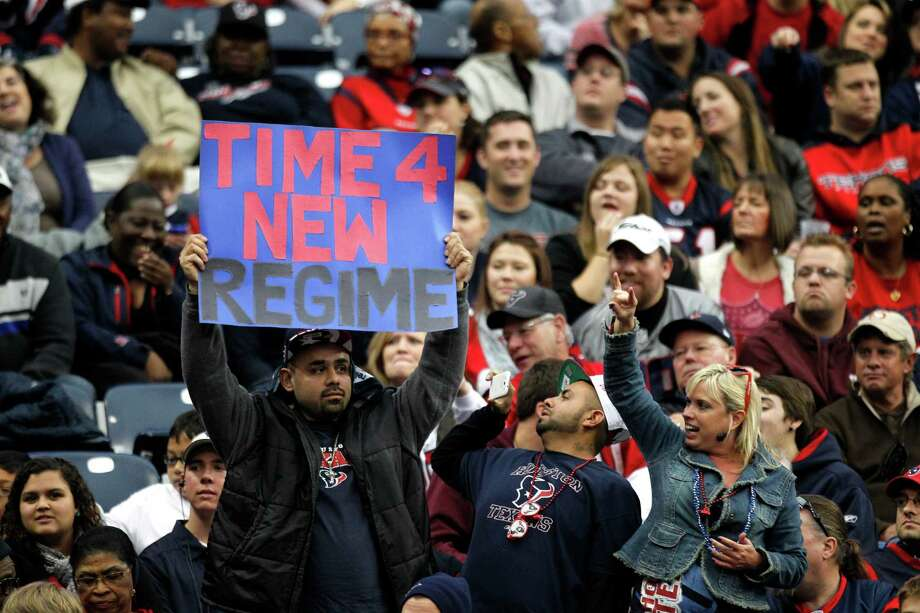 One of the Texans fans among a group who had yet to desert Reliant Stadium in the fourth quarter offers his suggestion to team owner Bob McNair. Photo: Brett Coomer, Staff / © 2013  Houston Chronicle