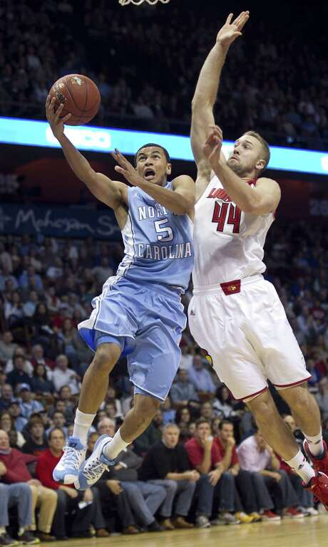 UNC's Marcus Paige has Louisville in pursuit as he did for much of his 32-point performance in the upset. Photo: Robert Willett, MBR / Raleigh News & Observer