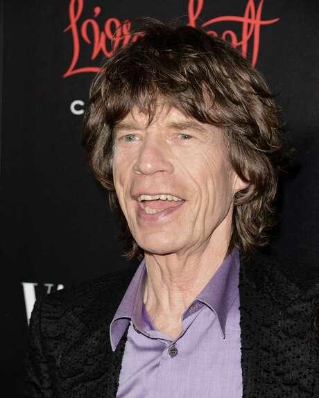 Mick Jagger léder de la banda de rock The Rolling Stones a su llegada a un desfile de moda en California el martes 19 de noviembre de 2013. Jade, hija del méºsico, indicé³ que éste se convertiré¡ en bisabuelo. (Foto de Dan Steinberg/Invision/AP) Photo: Dan Steinberg, INVL -end- / Invision