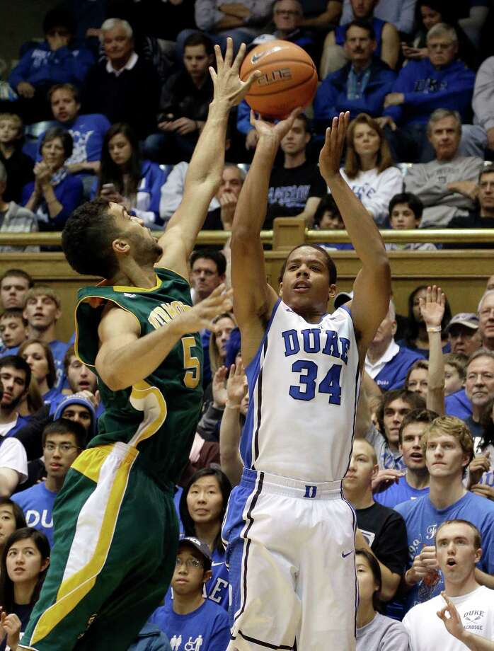 Duke's Andre Dawkins (34) shoots as Vermont's Hector Harold (5) defends during the first half of an NCAA college basketball game in Durham, N.C., Sunday, Nov. 24, 2013. (AP Photo/Gerry Broome) ORG XMIT: NCGB103 Photo: Gerry Broome / AP