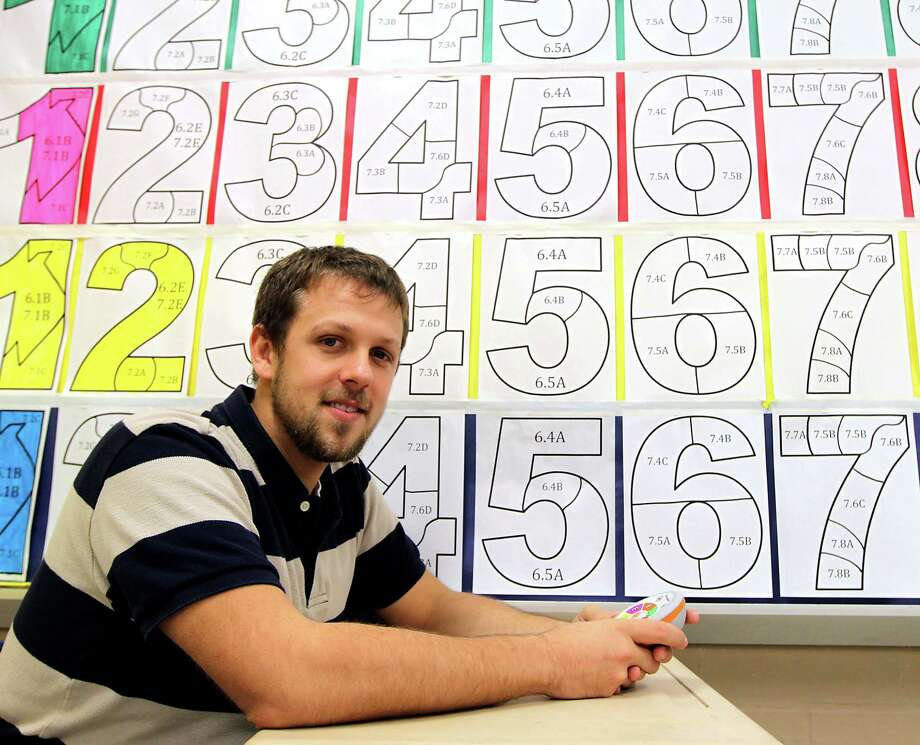 """I became a better person by teaching character,"" says Ryan Hambley, a math teacher  who leads the  character development program at KIPP Courage at Landrum Middle School. Photo: James Nielsen, Staff / © 2013  Houston Chronicle"