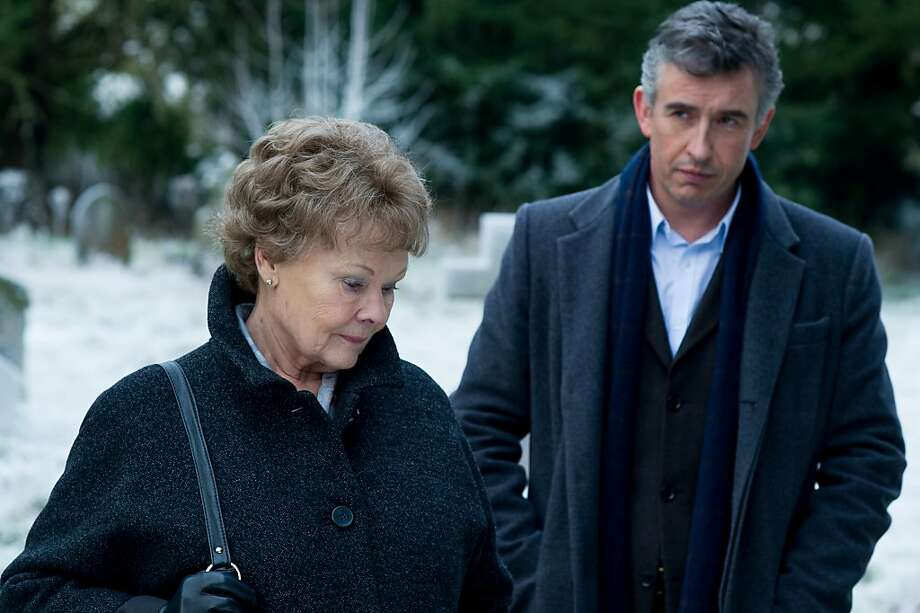 """This image released by The Weinstein Company shows Judi Dench, left, and Steve Coogan in a scene from """"Philomena."""" The British comic and Oscar-winning actress co-star in the film opening Friday, Nov. 22, 2013, which explores the benefits and costs of faith through the true story of Philomena Lee. (AP Photo/The Weinstein Company, Alex Bailey) Photo: Alex Bailey, Associated Press"""