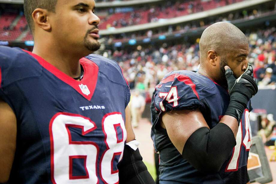 Tackle Ryan Harris (68) and guard Wade Smith (74) exit the field as part of a Texans offense that produced a mere 218 yards and two field goals on Sunday. Photo: Smiley N. Pool, Staff / © 2013  Houston Chronicle