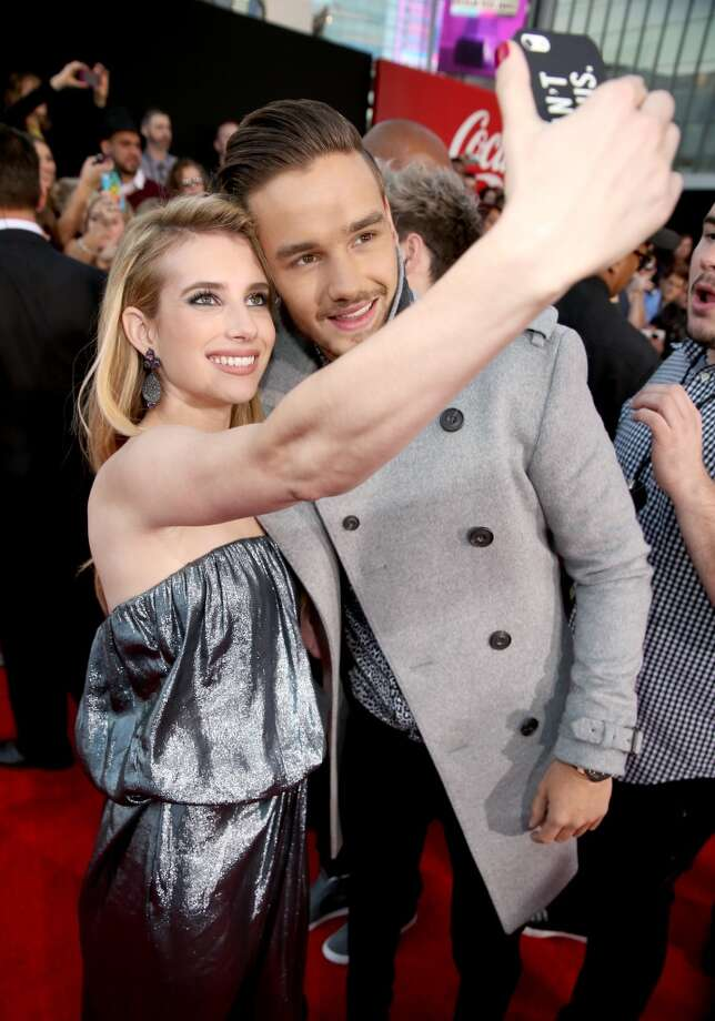 Actress Emma Roberts (L) and  Liam Payne attend the 2013 American Music Awards at Nokia Theatre L.A. Live on November 24, 2013 in Los Angeles, California.  (Photo by Christopher Polk/AMA2013/Getty Images for DCP) Photo: Christopher Polk/AMA2013, Getty Images For DCP