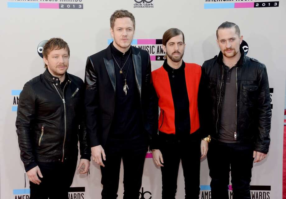 Musicians (L-R) Ben McKee, Dan Reynolds, Dan Platzman, and Wayne Sermon of Imagine Dragons attend the 2013 American Music Awards at Nokia Theatre L.A. Live on November 24, 2013 in Los Angeles, California.  (Photo by Jason Kempin/Getty Images) Photo: Jason Kempin, Getty Images