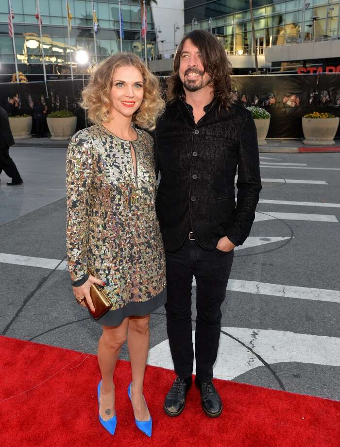 Musician Dave Grohl (R) and Jordyn Blum attend the 2013 American Music Awards at Nokia Theatre L.A. Live on November 24, 2013 in Los Angeles, California.  (Photo by Michael Buckner/AMA2013/Getty Images for DCP) Photo: Michael Buckner/AMA2013, Getty Images For DCP