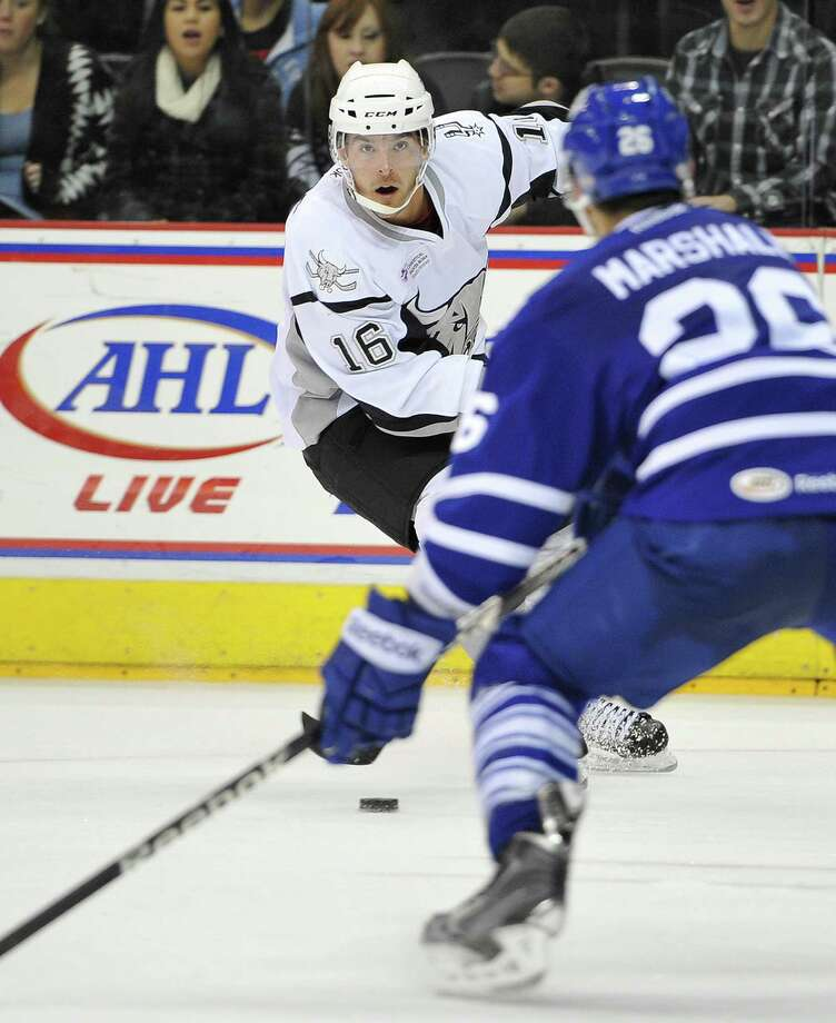 Rampage right wing Bobby Butler lines up a shot against Toronto's Kevin Marshall. The loss ended the Rampage's five-game home winning streak. Photo: Darren Abate / MD314.com