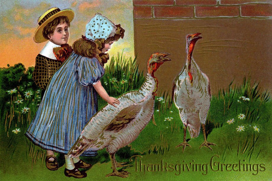 It's a little mean to let the kids bond with the turkeys, knowing what's coming. (circa 1900) Photo: Buyenlarge, Getty Images / Archive Photos