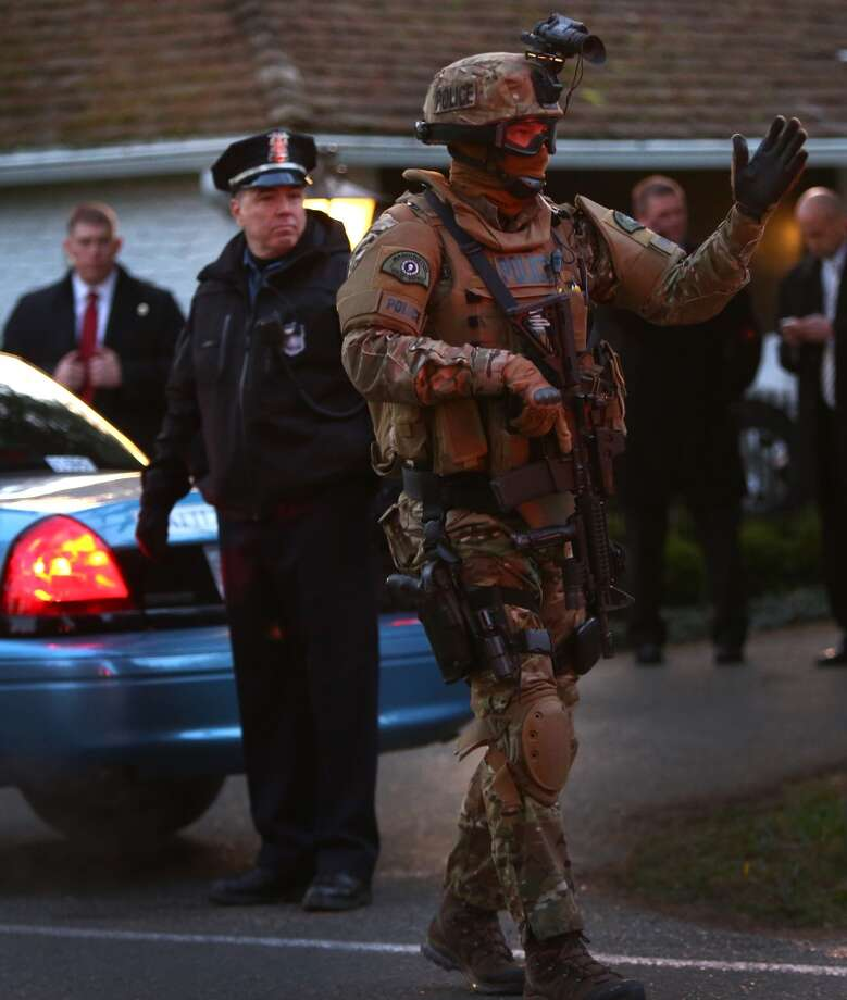 A member of the Washington State Patrol in tactical gear works security as people wait for the motorcade of U.S. President Barack Obama outside of a fundraiser at the northwest Seattle home of  business owner Tom Campion. Photo: JOSHUA TRUJILLO, SEATTLEPI.COM