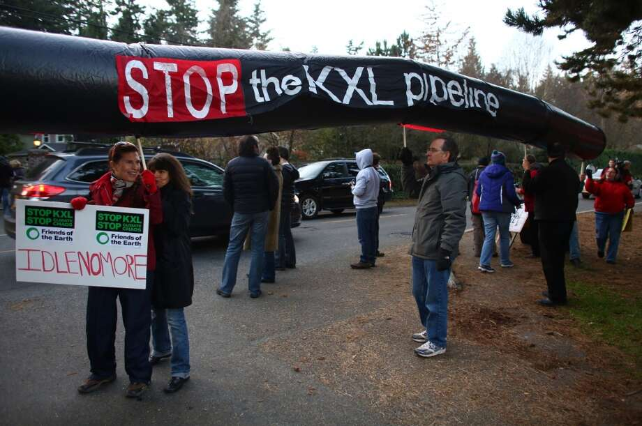 Protesters opposed to the Keystone XL pipeline wait for the motorcade of President Barack Obama. The president attended a fundraiser at the northwest Seattle home of business owner Tom Campion. Photo: JOSHUA TRUJILLO, SEATTLEPI.COM