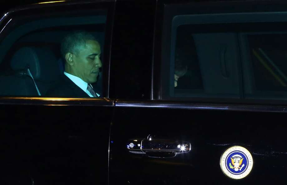President Obama is shown in the presidential limousine as he departs a fundraiser at the northwest Seattle home of business owner Tom Campion. Thick, protective glass on the car turned the president's face green in this photo. Photo: JOSHUA TRUJILLO, SEATTLEPI.COM