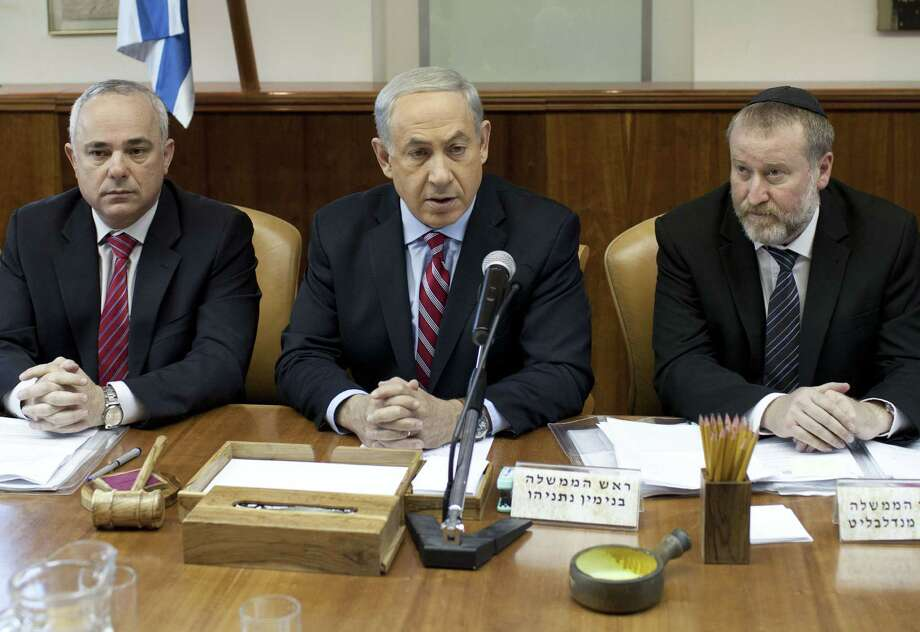 "Speaking to his Cabinet, Israeli Prime Minister Benjamin Netanyahu, center, said the deal made the world a ""more dangerous place."" Photo: ABIR SULTAN, Pool / AFP"