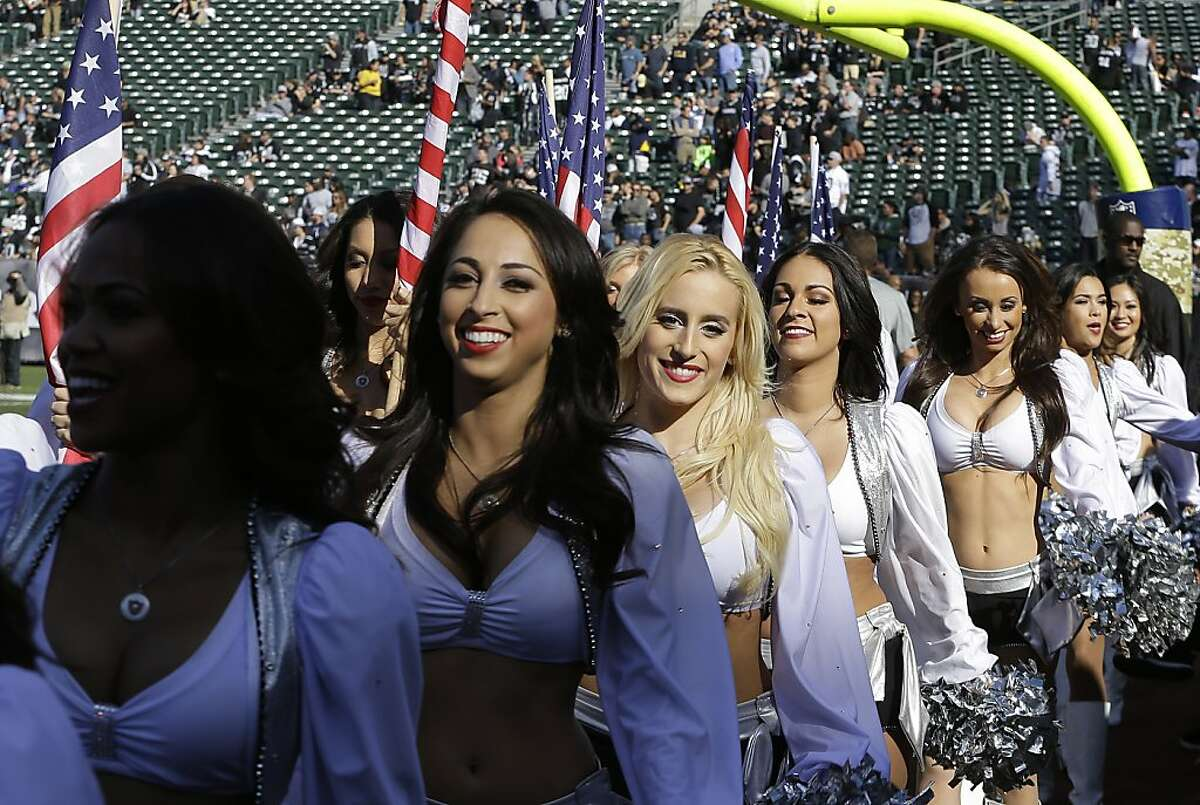 The Oakland Raiderettes perform last season at the Coliseum. Raiderette Lacy T. is accusing the team of failing to pay the cheerleaders minimum wage for all the work they do.