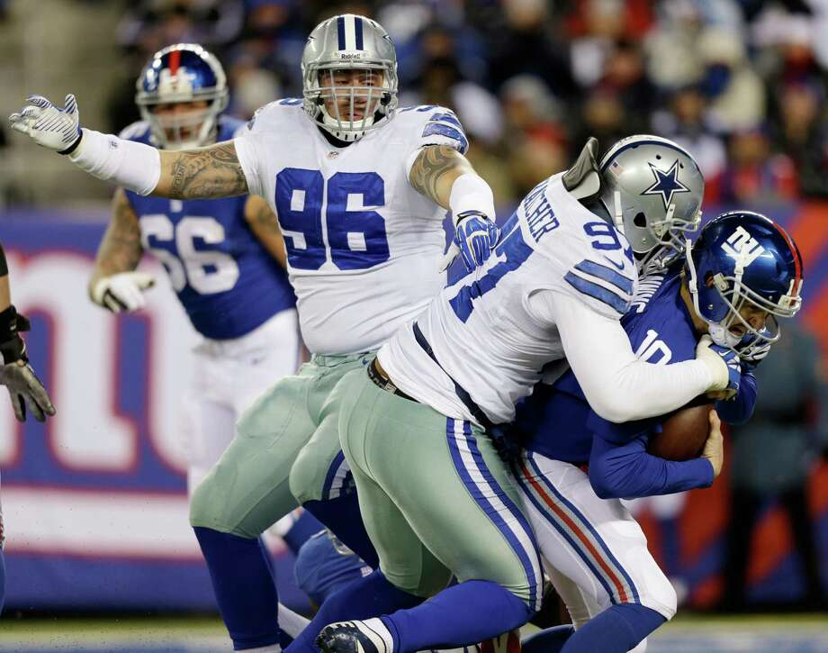 Defensive tackle Jason Hatcher, sacking Eli Manning, was one of the Cowboys who took particular joy in making some of the Giants eat their words. Photo: Frank Franklin II, STF / AP