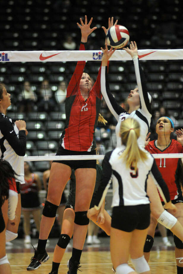 Karley York (white jersey at the net) is one of 12 Churchill players scheduled to return next year. Photo: For The Express-News