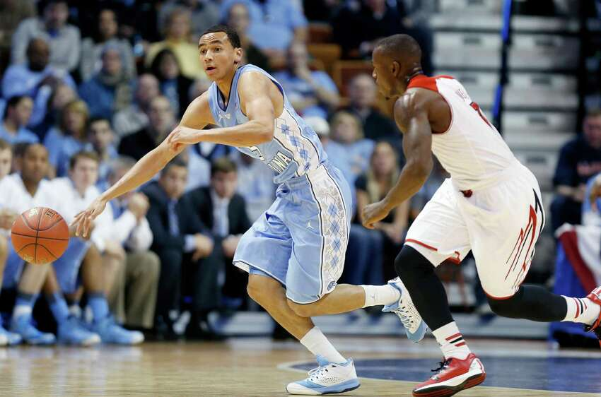File photo of Marcus Paige leading the way with a team-high 32 points as North Carolina topped Louisville 93-84.