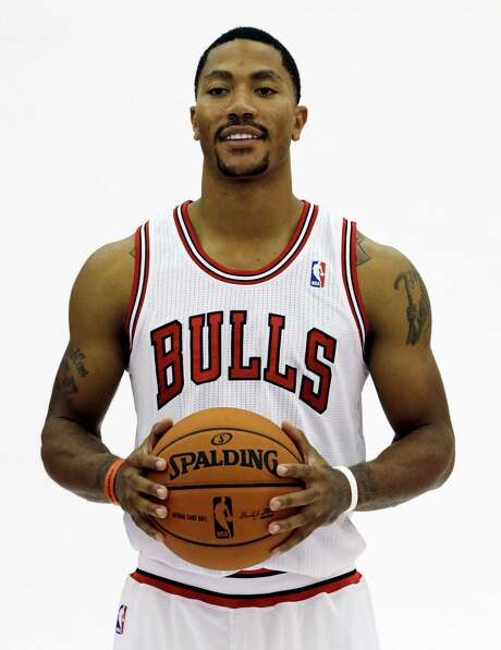 Chicago Bulls guard Derrick Rose poses for a photographer during NBA basketball media day at the Sheri L. Berto Center, Friday, Sept. 27, 2013., in Deerfield, Ill. (AP Photo/Nam Y. Huh) Photo: Nam Y. Huh, STF / AP