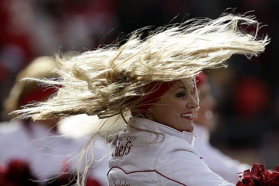A Kansas City Chiefs cheerleader performs during the first half of an NFL football game against the San Diego Chargers Sunday, Nov. 24, 2013, in Kansas City, Mo. (AP Photo/Charlie Riedel) Photo: Charlie Riedel, Associated Press