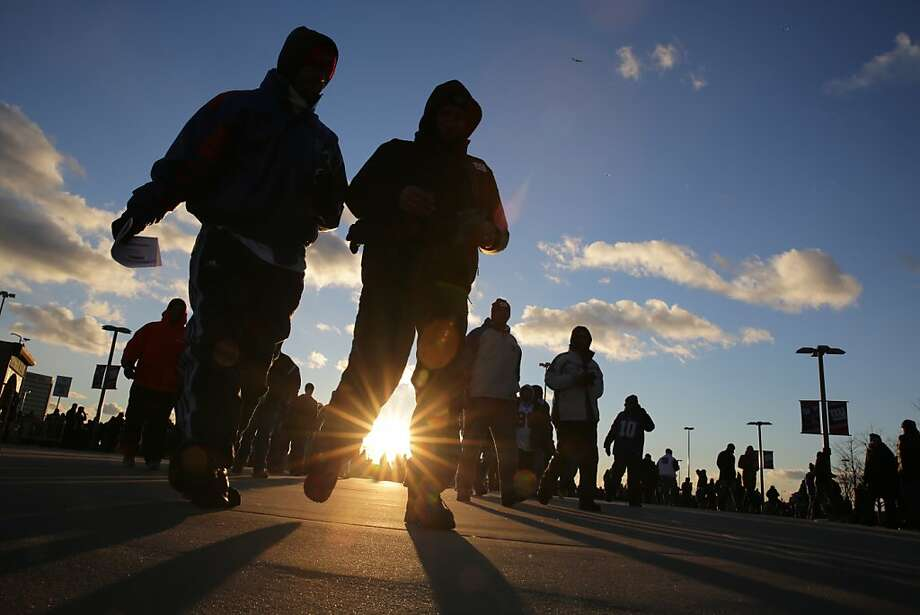 Fans arrive during the first half of an NFL football game between the Dallas Cowboys and the New York Giants Sunday, Nov. 24, 2013, in East Rutherford, N.J. (AP Photo/Peter Morgan) Photo: Peter Morgan, Associated Press