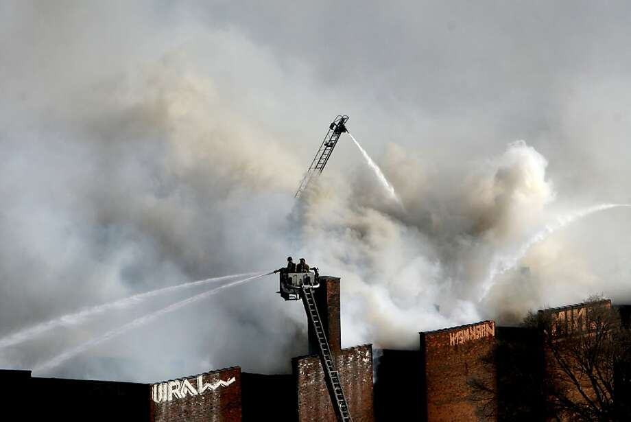 Detroit firefighters battle a blaze In the 1500 block of East Jefferson near downtown Detroit, Saturday Nov. 23, 2013. The fire destroyed the vacant apartment building. (AP Photo/Detroit Free Press, Mary Schroeder) Photo: Mary Schroeder, Associated Press