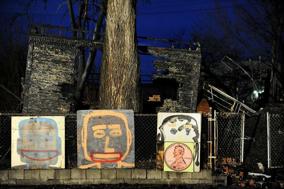 "Art work stands outside the Heidelberg Project outdoor art installation, after a fire in Detroit on Thursday, Nov. 21, 2013.   Arson investigators were at the scene of ""Penny House"" on the city's east side.  Fire crews were dispatched about 3 a.m., and the building was engulfed in flames at the time. No injuries or other damage was reported.  (AP Photo/The Detroit News, David Coates)   DETROIT FREE PRESS OUT; HUFFINGTON POST OUT Photo: David Coates, Associated Press"