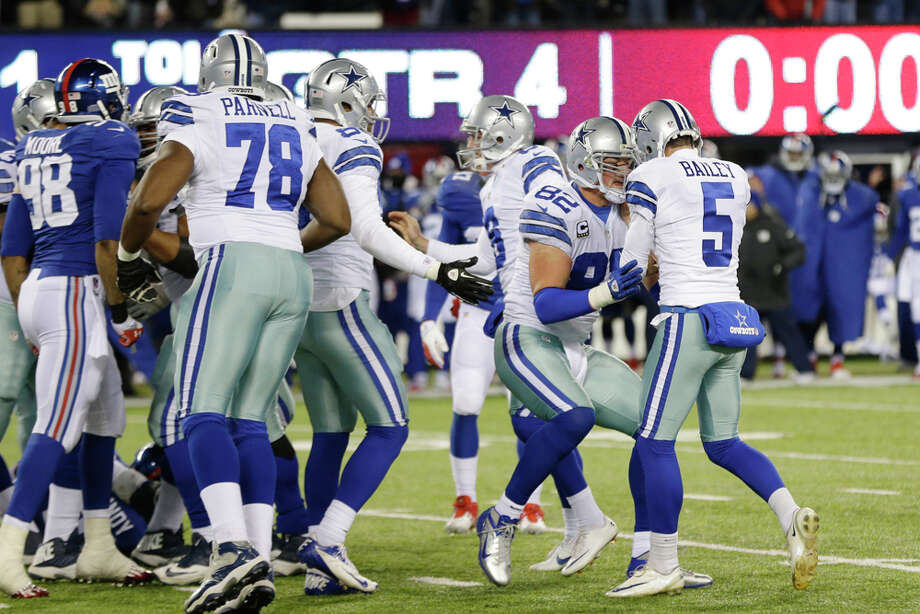 Dallas Cowboys tight end Jason Witten (82) and Dan Bailey (5) celebrate after Bailey kicked the game winning field goal during the second half of an NFL football game, Sunday, Nov. 24, 2013, in East Rutherford, N.J. The Cowboys won 24-21. (AP Photo/Seth Wenig) Photo: Seth Wenig, Associated Press / AP