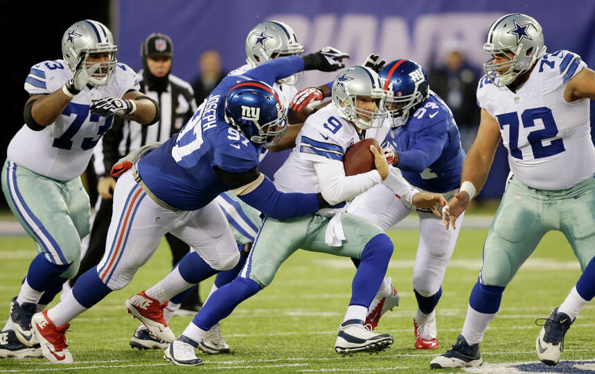 Dallas Cowboys quarterback Tony Romo (9) is tackled by New York Giants defensive tackle Linval Josep