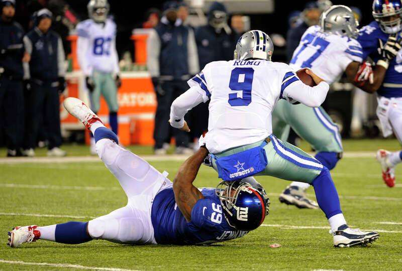 Dallas Cowboys quarterback Tony Romo (9) is sacked by New York Giants Cullen Jenkins (99) during the