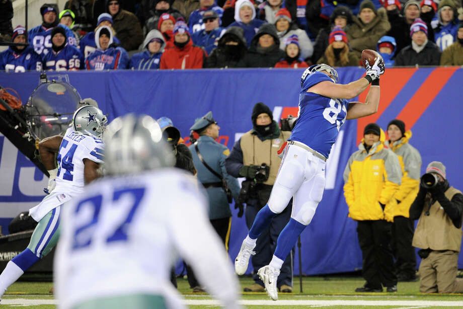 New York Giants tight end Brandon Myers catches a ball for a touchdown against the Dallas Cowboys during the second half of an NFL football game, Sunday, Nov. 24, 2013, in East Rutherford, N.J. (AP Photo/Bill Kostroun) Photo: Bill Kostroun, Associated Press / FR51951 AP