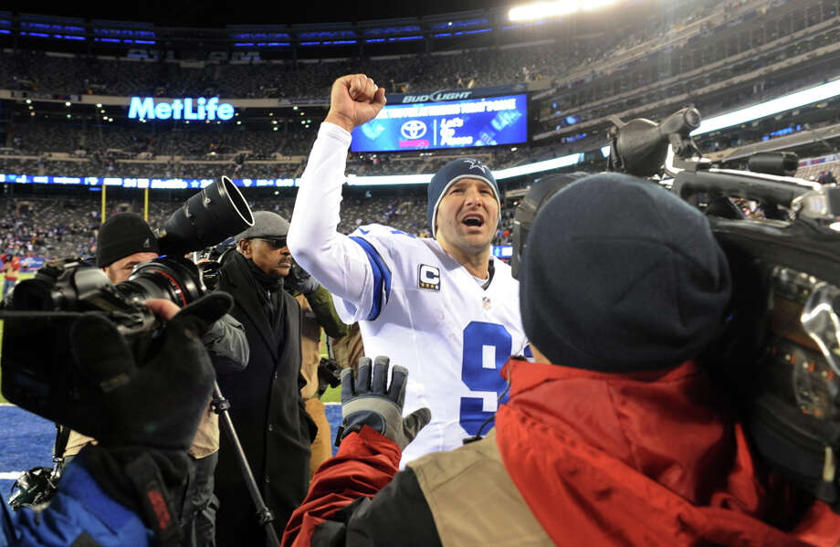 Dallas Cowboys quarterback Tony Romo (9) gestures while leaving the field after an NFL football game against the New York Giants, Sunday, Nov. 24, 2013, in East Rutherford, N.J. The Cowboys won 24-21. (AP Photo/Bill Kostroun) Photo: Bill Kostroun, Associated Press / FR51951 AP