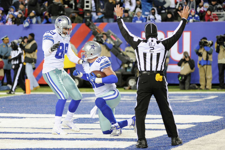 Dallas Cowboys tight end Jason Witten (82) celebrate a touchdown with teammate Gavin Escobar (89) during the first half of an NFL football game against the New York Giants Sunday, Nov. 24, 2013, in East Rutherford, N.J. (AP Photo/Bill Kostroun) Photo: Bill Kostroun, Associated Press / FR51951 AP