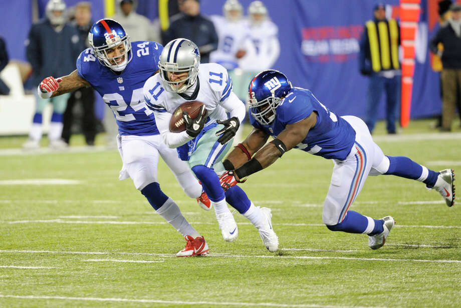 Dallas Cowboys wide receiver Cole Beasley (11) runs away from New York Giants middle linebacker Jon Beason (52) and Terrell Thomas (24) during the second half of an NFL football game, Sunday, Nov. 24, 2013, in East Rutherford, N.J. (AP Photo/Bill Kostroun) Photo: Bill Kostroun, Associated Press / FR51951 AP