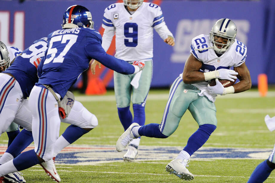 Dallas Cowboys running back DeMarco Murray (29) rushes during the second half of an NFL football game against the New York Giants Sunday, Nov. 24, 2013, in East Rutherford, N.J. (AP Photo/Bill Kostroun) Photo: Bill Kostroun, Associated Press / FR51951 AP