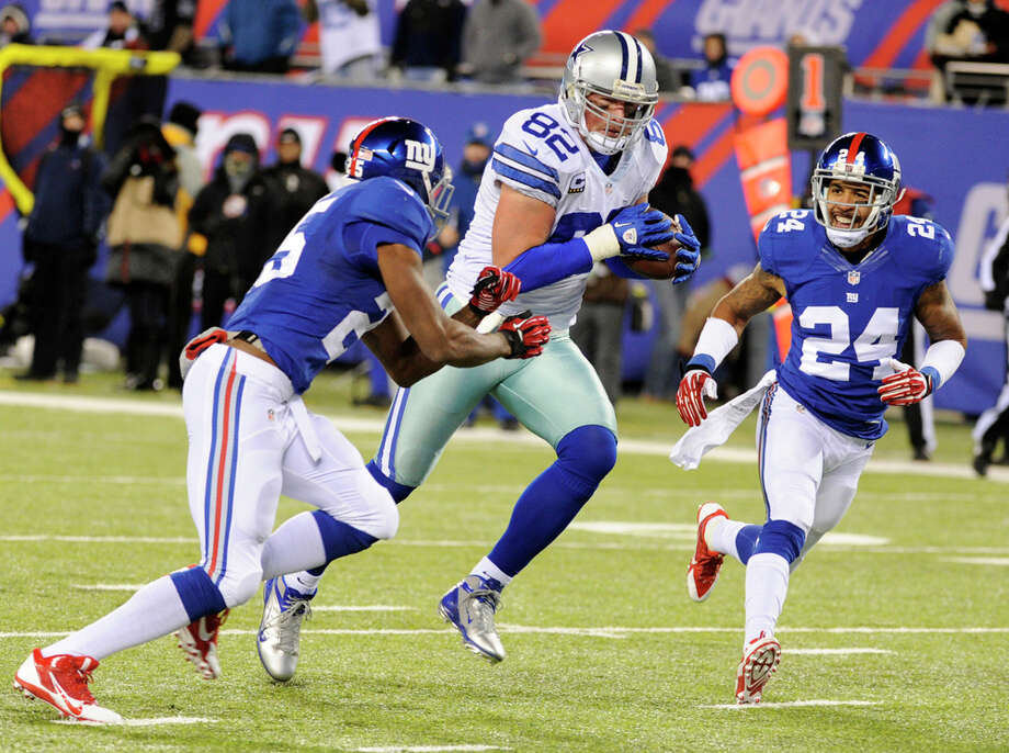 Dallas Cowboys tight end Jason Witten (82) scores a touchdown as New York Giants free safety Will Hill (25) and cornerback Terrell Thomas (24) defends on the play during the first half of an NFL football game Sunday, Nov. 24, 2013, in East Rutherford, N.J. (AP Photo/Bill Kostroun) Photo: Bill Kostroun, Associated Press / FR51951 AP