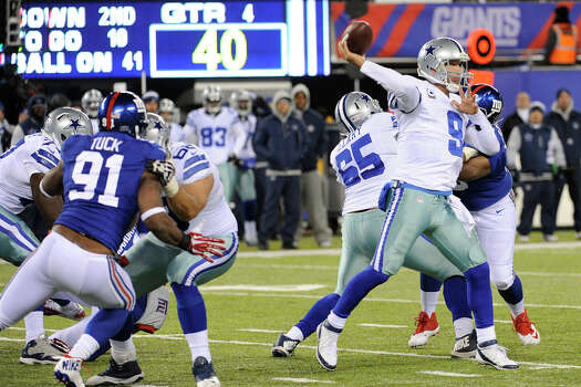 Dallas Cowboys quarterback Tony Romo (9) throws a pass during the second half of an NFL football game against the New York Giants, Sunday, Nov. 24, 2013, in East Rutherford, N.J. (AP Photo/Bill Kostroun) Photo: Bill Kostroun, Associated Press / FR51951 AP