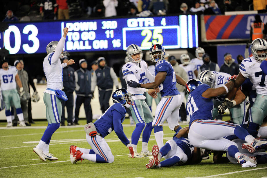 Dallas Cowboys kicker Dan Bailey (5) watches the ball after kicking the game winning field goal during the second half of an NFL football game against the New York Giants, Sunday, Nov. 24, 2013, in East Rutherford, N.J. The Cowboys won 24-21. (AP Photo/Bill Kostroun) Photo: Bill Kostroun, Associated Press / FR51951 AP