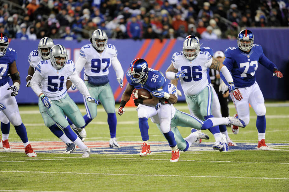 New York Giants running back Andre Brown (35) is tackled during the second half of an NFL football game against the Dallas Cowboys Sunday, Nov. 24, 2013, in East Rutherford, N.J. (AP Photo/Bill Kostroun) Photo: Bill Kostroun, Associated Press / FR51951 AP
