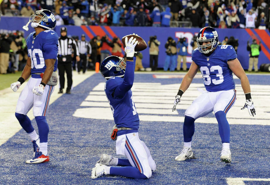New York Giants wide receiver Louis Murphy, center, celebrates with teammates Victor Cruz, left, and Brandon Myers after Murphy caught a touchdown pass from quarterback Eli Manning during the second half of an NFL football game, Sunday, Nov. 24, 2013, in East Rutherford, N.J. (AP Photo/Bill Kostroun) Photo: Bill Kostroun, Associated Press / FR51951 AP