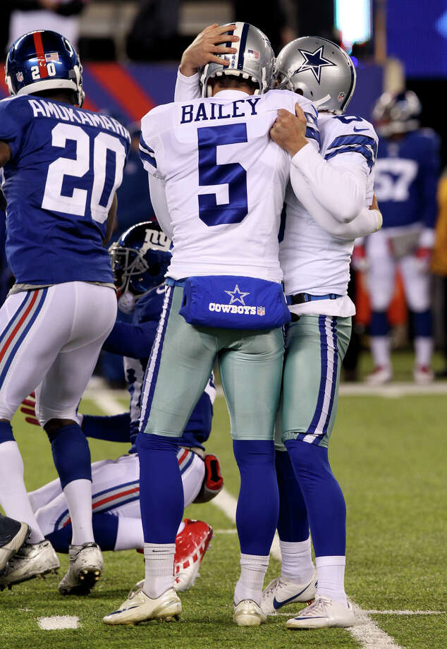 Dallas Cowboys kicker Dan Bailey (5) is congratulated by Chris Jones, right, after kicking a game-winning field goal against the New York Giants during the second half of an NFL football game, Sunday, Nov. 24, 2013, in East Rutherford, N.J. The Cowboys won 24-21. (AP Photo/Peter Morgan) Photo: Peter Morgan, Associated Press / AP