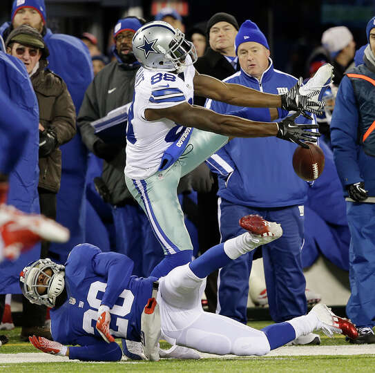 Dallas Cowboys wide receiver Dez Bryant, top, is unable to catch a pass from quarterback Tony Romo a