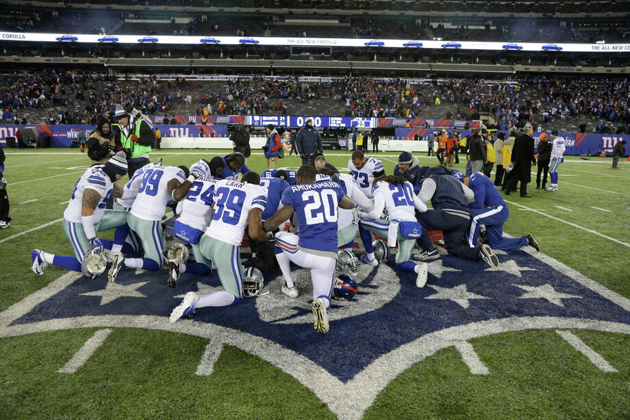New York Giants cornerback Prince Amukamara (20) and Dallas Cowboys' Brandon Carr (39) join teammates after an NFL football game, Sunday, Nov. 24, 2013, in East Rutherford, N.J. The Cowboys won 24-21. (AP Photo/Seth Wenig) Photo: Seth Wenig, Associated Press / AP