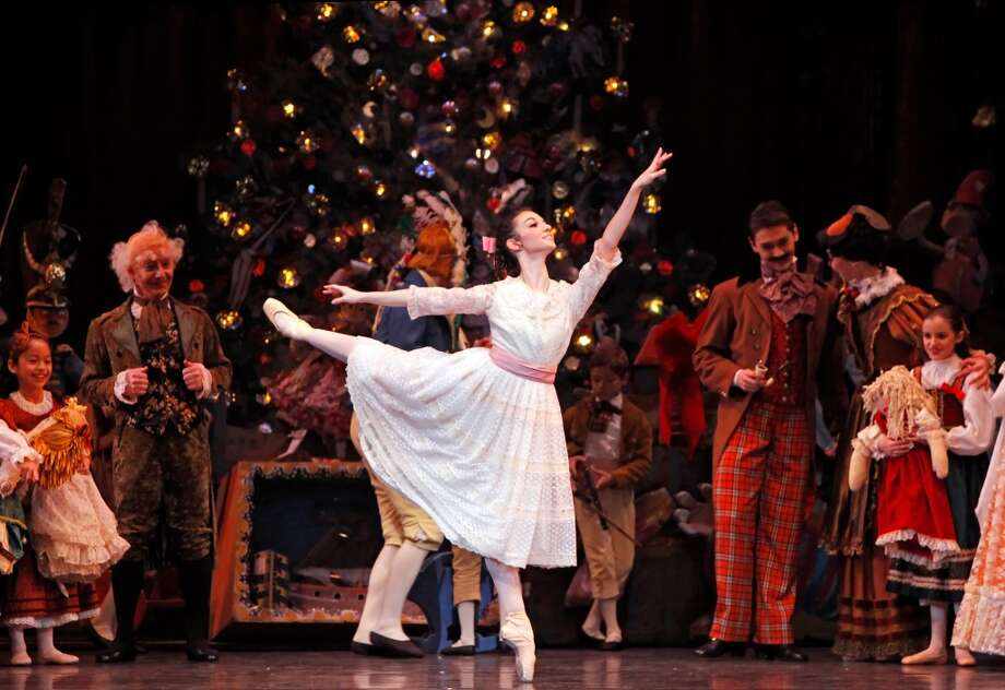 "In the Houston Ballet's production of the classic holiday tale ""The Nutcracker,"" Clara marvels at the Christmas tree, flying cooks, the Sugar Plum Fairy and a prince dancing. Pictured: Emily Bowen Photo: Courtesy Photo, Amitava Sarkar/Houston CVB"