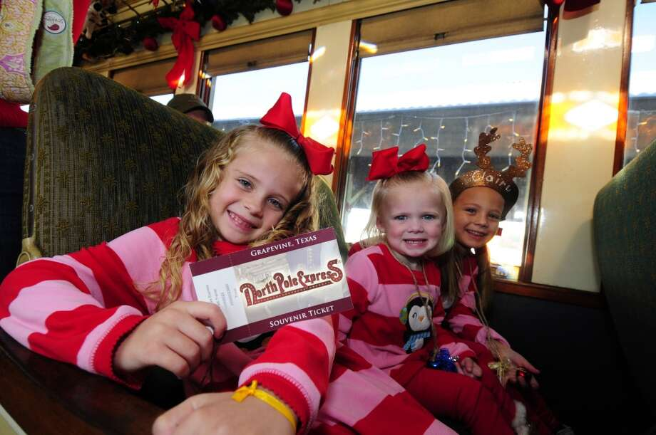 Children ride in decorated Victorian rail coaches aboard Grapevine's North Pole Express. Photo: Courtesy Photo, Grapevine CVB