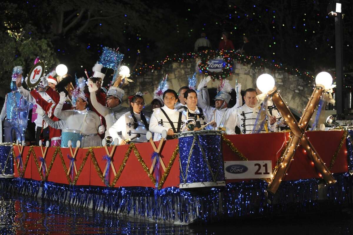 Members of the San Antonio Street Dance and Drum float display their first-place ribbon during the 30th annual Ford Holiday River Parade on the River Walk in San Antonio in 2012.