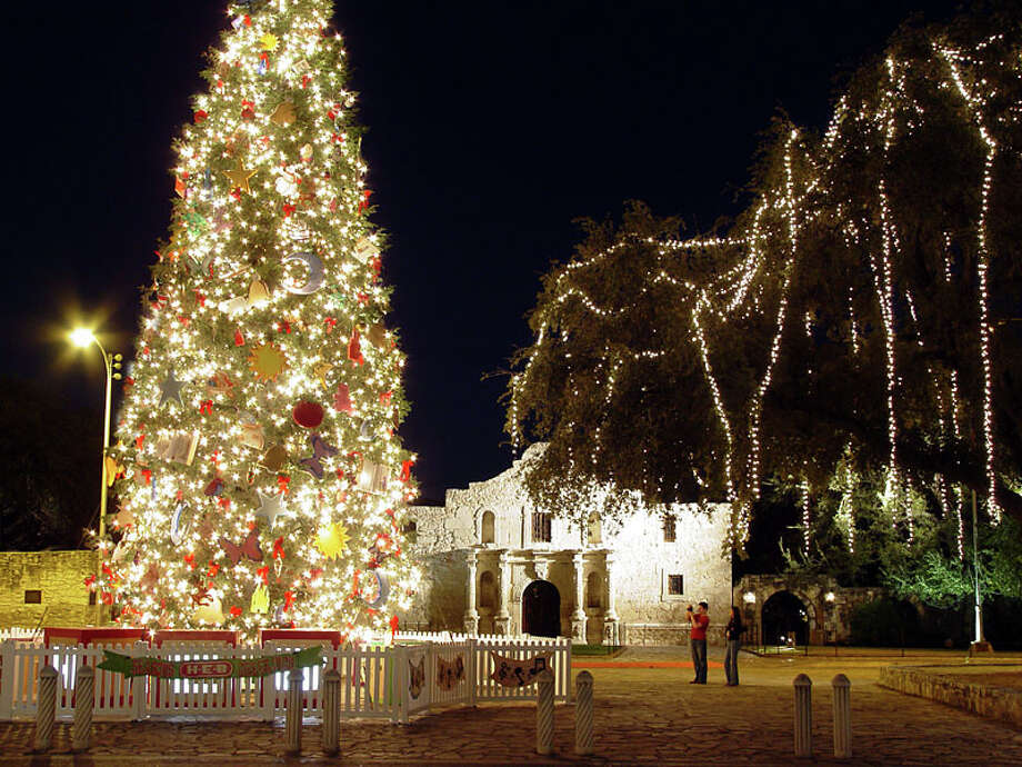 Visitors and locals alike flock to the Alamo in San Antonio to see the lighted tree after Thanksgiving. Photo: Semon Tam, For The Express-News
