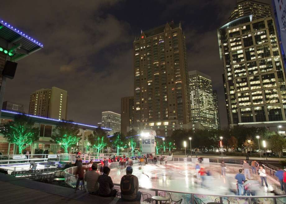 At Houston's Discovery Green Park, ice skaters circle the rink with the city skyline as the backdrop. Photo: Courtesy Photo, Houston CVB