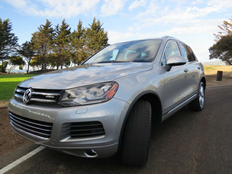 On the road, the Touareg hybrid is quiet and, when you need it, quite fast. The combination of supercharged three-liter V6 333-horsepower engine and 47-horsepower electric motor (380 bhp, in all) is enough to get the car up to extra-legal speeds in a matter of seconds. Even if you're hauling five people and a bunch of luggage, the car is still pretty fast.