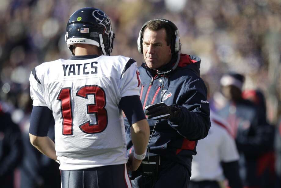Gary Kubiak talks with quarterback T.J. Yates during the Texans' 20-13 loss to the Baltimore Ravens in the AFC Divisional playoff round on Jan. 15, 2012. Photo: Brett Coomer, Houston Chronicle